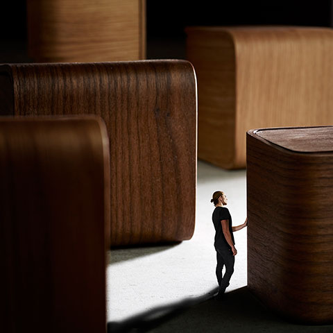 Man walking between wood blocks.